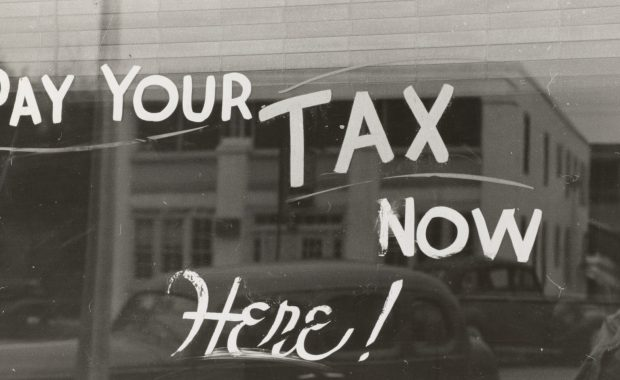 Pay your tax sign on window